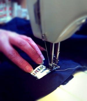 Adding customer brand labels to clothing